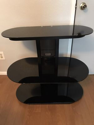 Chic multi- purpose glass 3 levels $100. measurements; 30 inches high , 32 inches wide ,17 inches deep tv stand furniture can hold tv on top for Sale in Fresno, CA