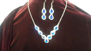 Stimulated diamonds and safires necklace and earrings for Sale in Auburndale, FL