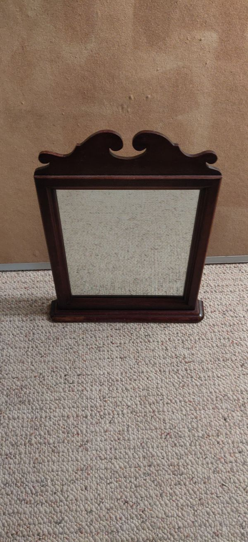 Wood-framed vanity mirror