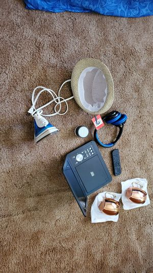 Two beer 🍻 cup and portable Bluetooth DVD player and headphones and speaker and iron and One heat for Sale in Fillmore, CA