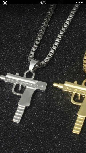 Supreme uzi chain necklace silver and gold for Sale in Phoenix, AZ