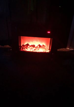 Electric heater fireplace display heater works great winter time approaches for Sale in Norfolk, VA