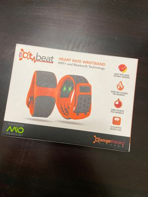 Orangetheory wristbands and chargers for Sale in Los Angeles, CA