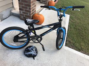 20 inch Mongoose bike and Mongoose Helmet for Sale in Durham, NC