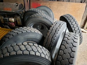 Set of 8 Log truck or trailer tires and steel budd wheels for Sale in Chehalis, WA