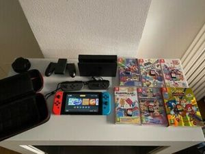 Nintendo switch 2019 console bundle with Games and Accessories. for Sale in Elk Grove Village, IL