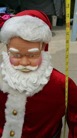 Santa clause de 4 pies de alto vuenas condisiones y canta for Sale in Baldwin Park, CA
