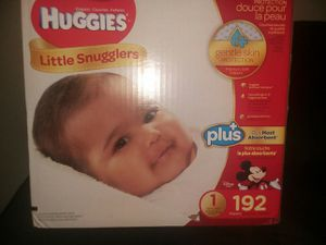 Box Of Huggies Diapers. 1 Pack Was Used But Their To Small For My Son Now. There's 128 Instead Of 192 for Sale in Colorado Springs, CO