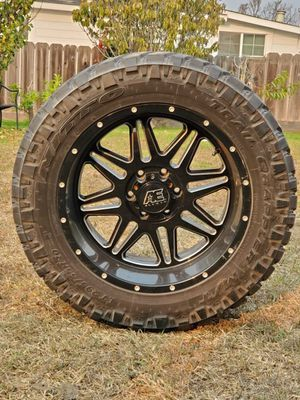 "Alloy 20"" rims and nitto tires 295/55R20 all terrain for Sale in Salinas, CA"