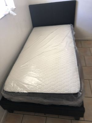 Twin size bed frame new in the box with the mattresses and free shipping for Sale in Hialeah, FL