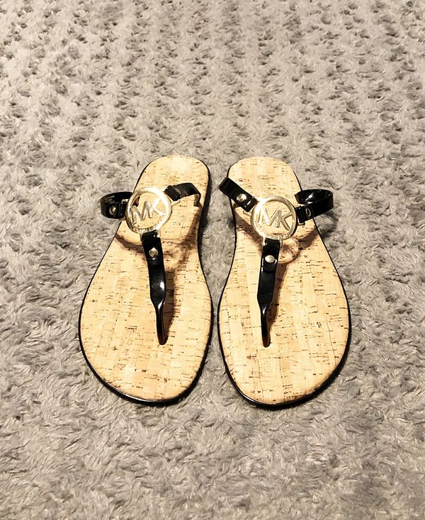 New! Women's Michael Kors sandals paid $75 size 9 Brand New never worn. Michael Kors Womens MK Charm Jelly Sandal Black with Gold Hardware.