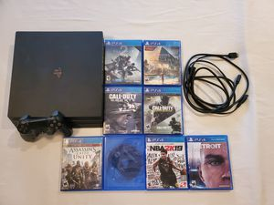 PS4 PRO WITH 8 GAMES for Sale in Las Vegas, NV