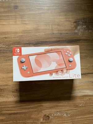 Nintendo Switch Lite (Coral) for Sale in Houston, TX