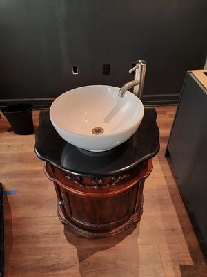 Carved Wood Vanity with Granite Counter, White Sink and Stainless Steel Faucet for Sale in Mercer Island, WA