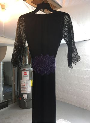 Child size 8 black witches dress with purple belt and purple witches hat for Sale in Columbus, OH