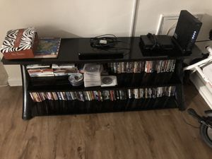 Black glass Tv stand for Sale in Baltimore, MD