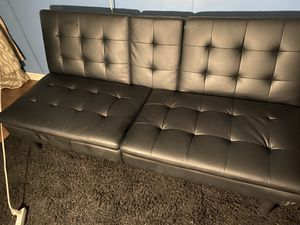 Black leather futon sofa bed for Sale in Victorville, CA