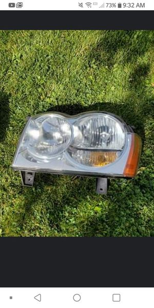 Use but like new headlights for a 2006 Jeep Grand Cherokee Laredo for Sale in Denver, CO