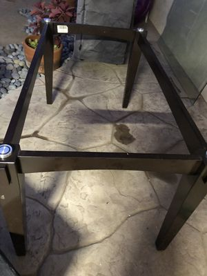 Free glass dining table. I was moving it and broke a piece corner. If you can glue it or over a table cloth. Yours for free. Table stand itself in g for Sale in Bonita, CA