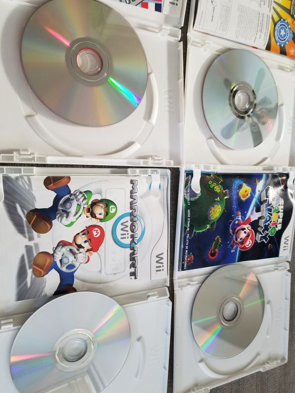 4 Nintendo Wii Games: Mario Kart, Super Mario Galaxy, Punch Out!!, and Cooking Mama