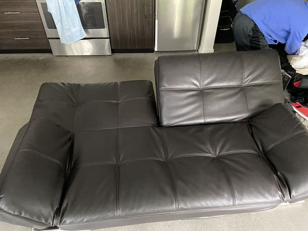 Selling a black, leather FUTON sofa!