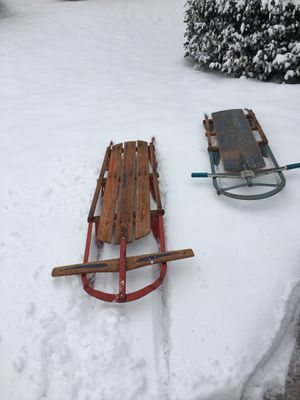 Two vintage sleds, red one is flexible radio flyer with metal runners, room for parent & child, really goes, blue one vintage too. Buy one or two, Be for Sale in Vienna, VA