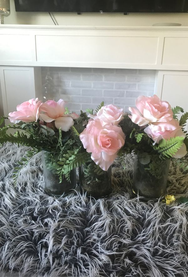 Three small vases with flowers
