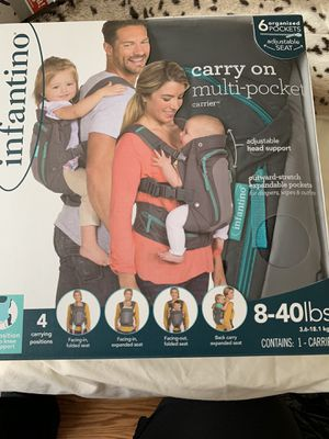 Infantino 4 in 1 carry on multi pocket carrier for Sale in Alexandria, VA