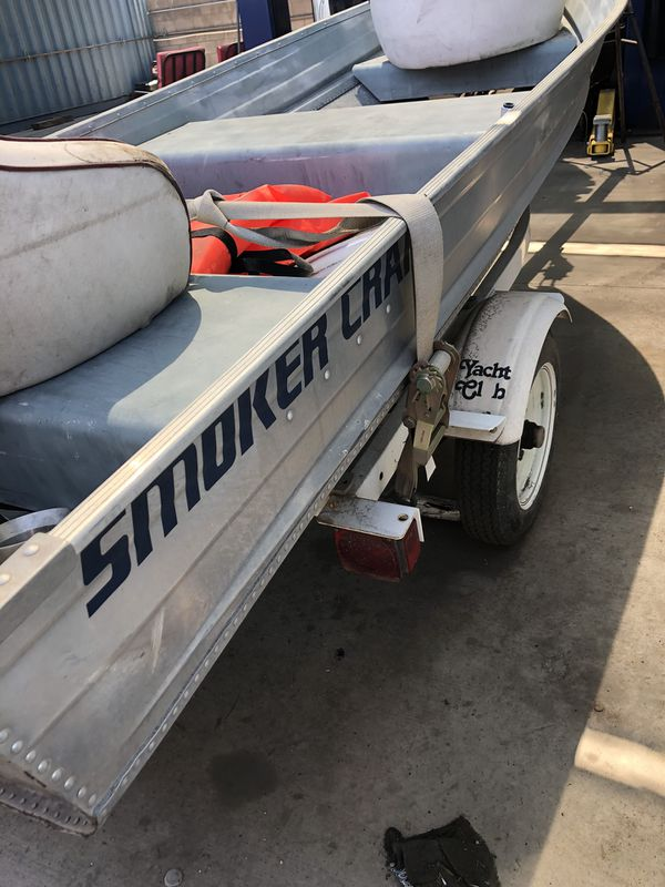 12 ft aluminum fishing boat w trailer and motor
