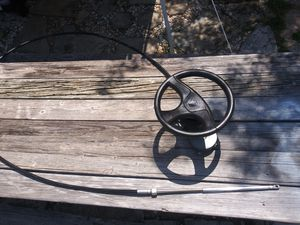Boat steering wheel and 11 and a half foot cable with Hardware for Sale in Eustis, FL