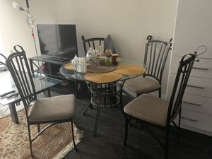 Metal and glass table with four chairs for Sale in Baltimore, MD