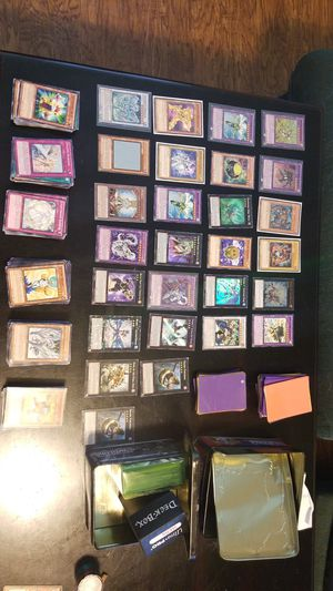 Yugioh cards w/sleeves, deck boxes, and tin cases for Sale in Houston, TX
