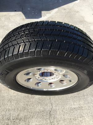 Used set of michelin tires and 8 lug rims for Sale in Orlando, FL