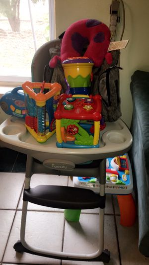 Baby stuff! High chair, toys and Eddie Bauber diaper bag for Sale in Austin, TX