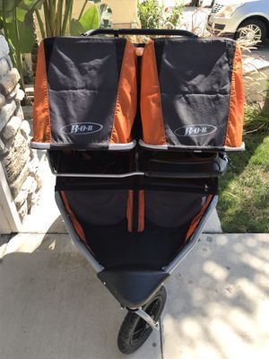 DOUBLE BOB JOGGING STROLLER W/ALL ATTACHMENTS EXCELLENT CONDITION for Sale in Rancho Cucamonga, CA