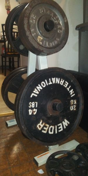 Olympic set weights and bench set for Sale in Rockmart, GA