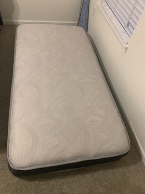 Twin bed with metal foldable frame for Sale in Tampa, FL