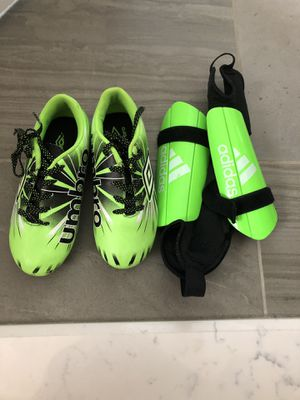 Kids soccer shoes and shin guards used twice for Sale in Ashburn, VA