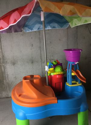 Kids water table and a bucket of sand toys for Sale in Elbert, CO