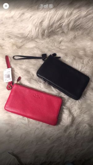 Selling 2 new coach oversized leather wristlets for Sale in Naples, FL