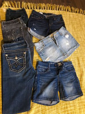 Bag of woman's clothes size medium, jeans shorts blouses , shirts and skirts for Sale in Phoenix, AZ