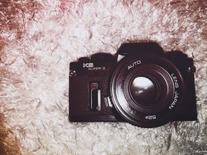 Sears Sears KS Super II SR 2000 Film Camera with 2 lenses and a canon speed light for Sale in Houston, TX