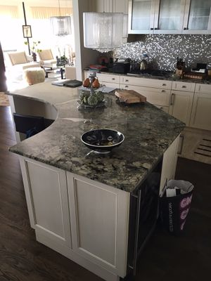 Kitchen cabinets and granite countertop, with metal inserts, and sink. Matching drop in cooktop(Thermador $850- sold separately) for Sale in Des Plaines, IL