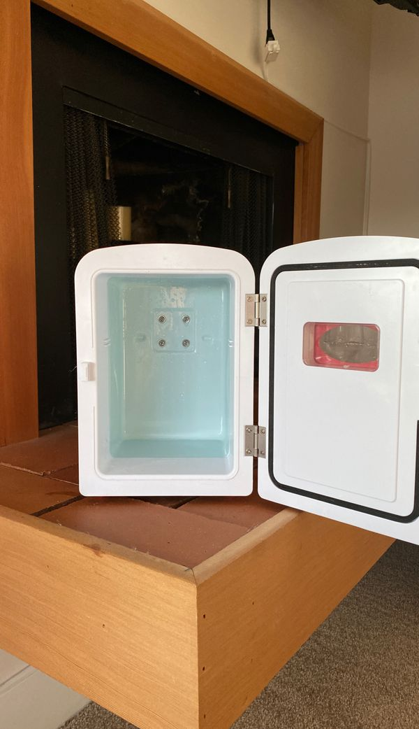 Mini soda fridge used to store baby milk