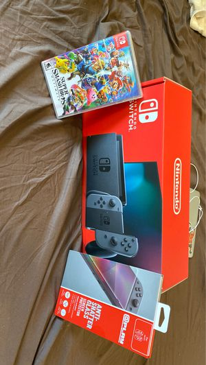 Nintendo Switch Console w/Gray Joy-Con with Screen Protector and Super Smash Bros. Ultimate System Bundle for Sale in Philadelphia, PA