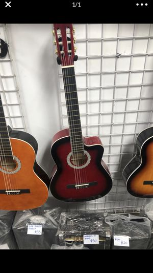 Brand new red wooden cutaway guitar brand new with box for Sale in Las Vegas, NV