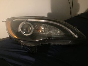 2013 Chrysler 200 right side headlight for Sale in Hanover, MD