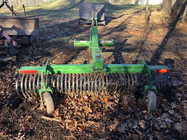 Woods 6ft rock rake/ landscape rake with wheels.