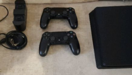 ps4 Slim 1TB bundle 2 controllers for Sale in St. Louis,  MO