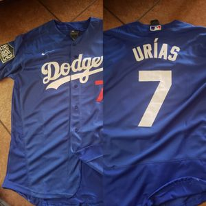 Dodgers urias blue jersey with 2020 World Series patch size medium to 3xl stitched firm price pick up only for Sale in Moreno Valley, CA